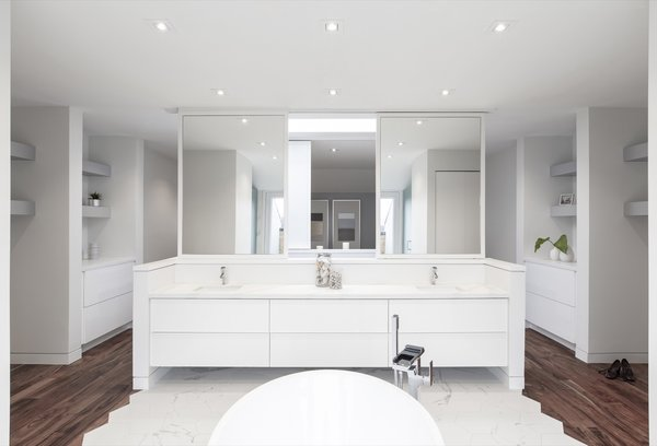 Large mirrors on sliding tracks bounce greater amounts of light into the room.