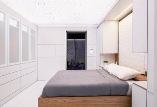 The FutureHAUS team converted a Sleep Number 360 smart bed into a Murphy bed that rises to reveal a dressing room smart mirror with an RFID wardrobe database that can help pick out and locate clothes. The wall can move to create an expanded bedroom, office space, or living room.