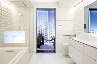 Designed to accommodate virtually any user, the bathroom comprises two separate areas—one for bathing and showering, and one with a toilet, vanity, and touchscreen smart mirror. A closed-loop water recycling system in the shower cuts down on water usage by 90 percent compared to standard showers.