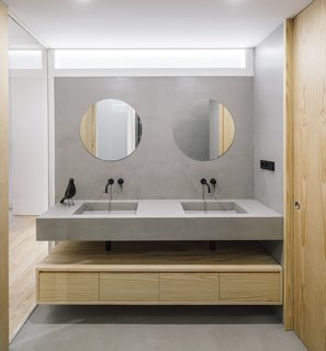 Waxed concrete surfaces define the minimalist bathroom.