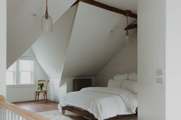 """""""The homeowners wanted a bright and airy look, with a side of boho,"""" says Claude of the master suite."""