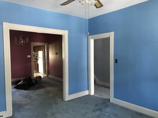 Before: the hardwood floors were previously covered in carpeting, which Claude and Chris later removed. All the walls  seen in this picture were removed during the renovation.