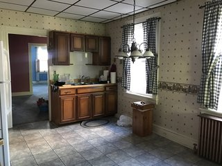 Before: the wall with the cabinets was removed to improve access to natural light and sight lines of the dining and living rooms.