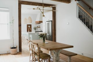 A sense of openness was achieved by tearing down the wall that divided the kitchen and dining room. Part of the wall that had concealed the staircase was also removed to expose the railing.