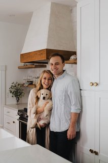 Hailey Stoner and Jeremie Patrick pictured with their dog in their new kitchen. The 1,800-square-foot house has four bedrooms, but the couple plan on waiting to renovate the other three.