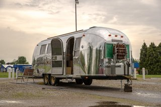 With its original aluminum facade polished to a high shine, the fully restored Airstream is designed to go off-the-grid with rooftop solar panels with an inverter, a composting toilet, and a large water tank.