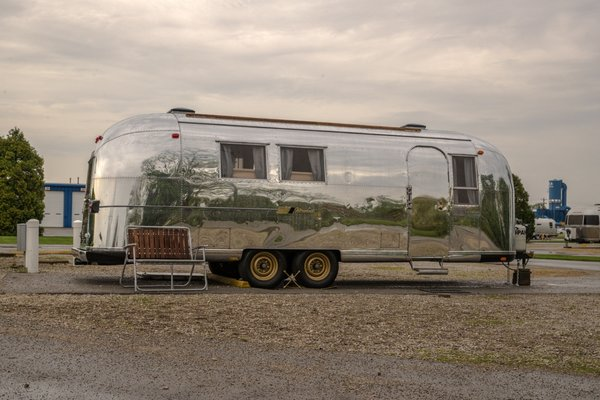 "The Airstream was christened the Navajo Maiden after a postcard the couple found inside the Airstream with a picture of a Native American woman and the words ""Navajo Maiden"" on the front."