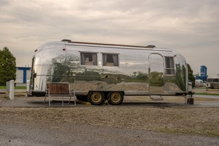 """The Airstream was christened the Navajo Maiden after a postcard the couple found inside the Airstream with a picture of a Native American woman and the words """"Navajo Maiden"""" on the front."""