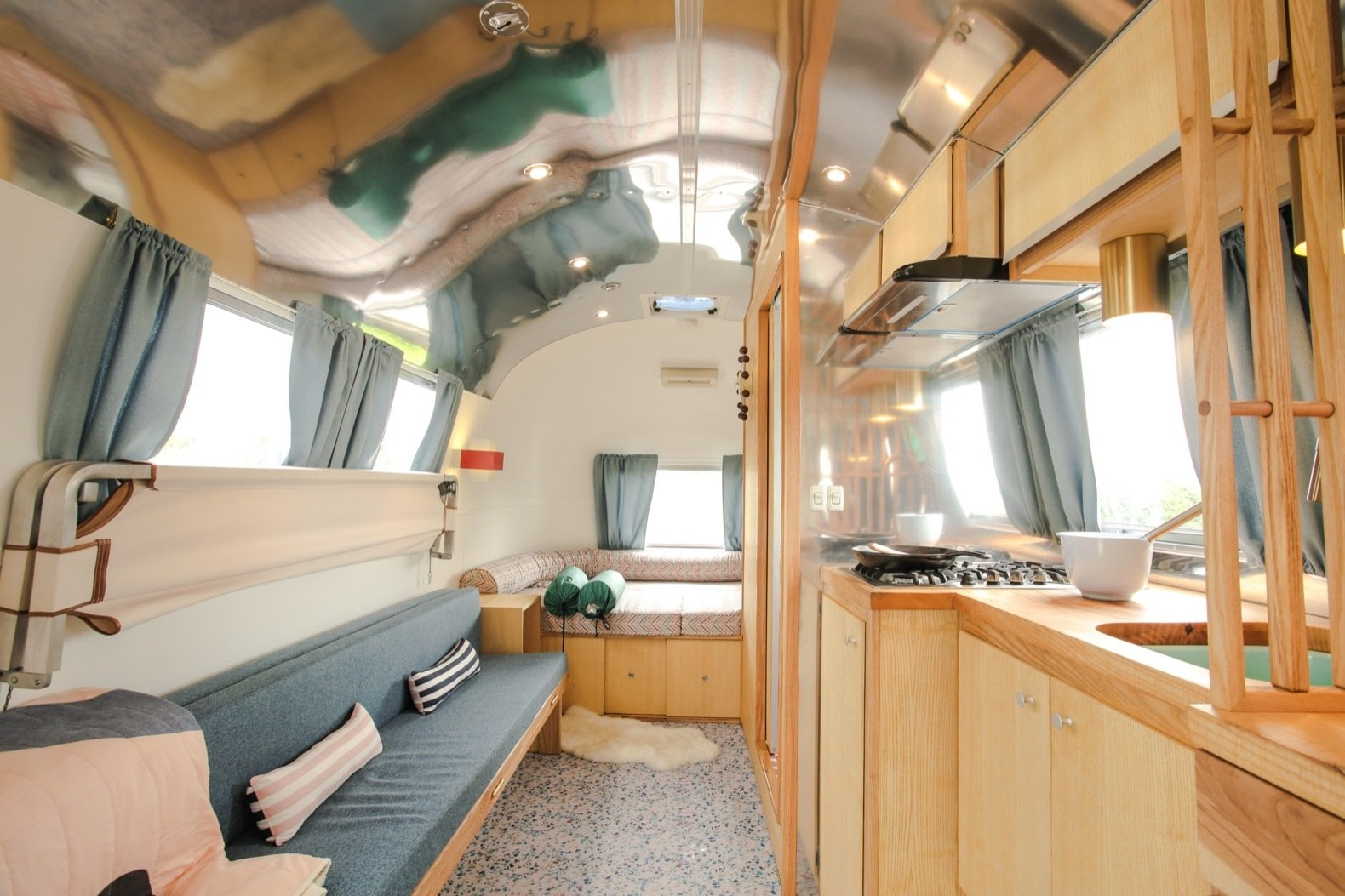 Furnishings fold away to create a sense of spaciousness in the compact Airstream. The vinyl floor is from Altra floor in the UK.