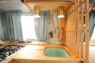 Cedar & Moss lights are installed above the robin's egg blue sink.