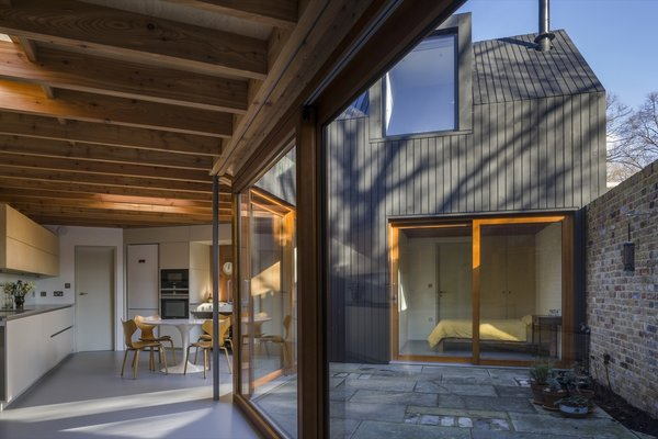 """The sheltered courtyard provides a quiet respite from the hustle and bustle of city living. """"From anywhere on the ground floor, all that can be seen are trees, sky, and the church tower,"""" says Pile."""