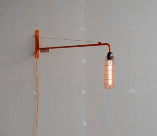 Abloh redesigned Prouvé's 1942 Petite Potence lamp with an LED bulb in an oblong cage and finished it in orange lacquer. Abloh's version is available in a numbered edition of 300 pieces.