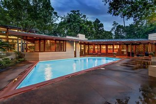 The parallelogram-shaped pool is located right outside the Thaxton House master bedroom.