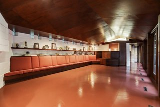 """8"""" x 8"""" windows top the concrete block walls. Polished red concrete floors feature throughout the home."""
