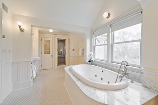 The master bath features a whirlpool tub, two sinks, a water closet with bidet, two sinks, and a steam shower.