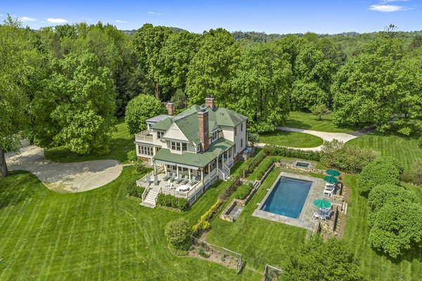 After almost 30 years, legendary actress Glenn Close is bidding adieu to New York's Bedford Hills with the sale of Beanfield, her dreamy farmhouse home located just an hour from the heart of Manhattan. Set on a 10.8-acre property surrounded by country estates, Beanfield enjoys secluded privacy and a beautiful setting of old-growth trees, stone walls, open meadows, and stellar plantings.