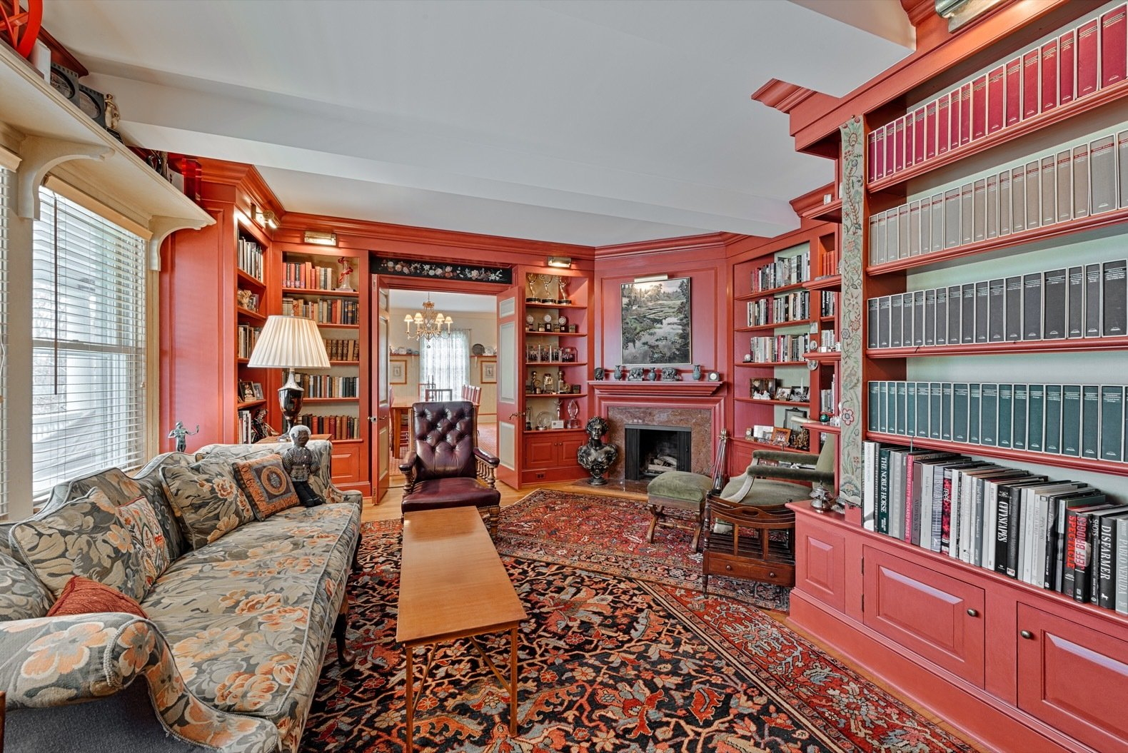Office, Shelves, Medium Hardwood, and Library Located to the left of the entrance is the library, which includes a fireplace, built-ins, and two doors that open up to the dining room.   Office Medium Hardwood Library Shelves Photos from Glenn Close Lists Her Storybook Estate in New York For $3.6M