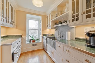 Off of the dining room is the butler's pantry with a beautiful soapstone sink.