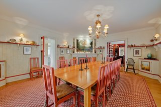 The dining room's warm color scheme was inspired by the Lilla Hytnnas dining room by Swedish artist Carl Larsson.