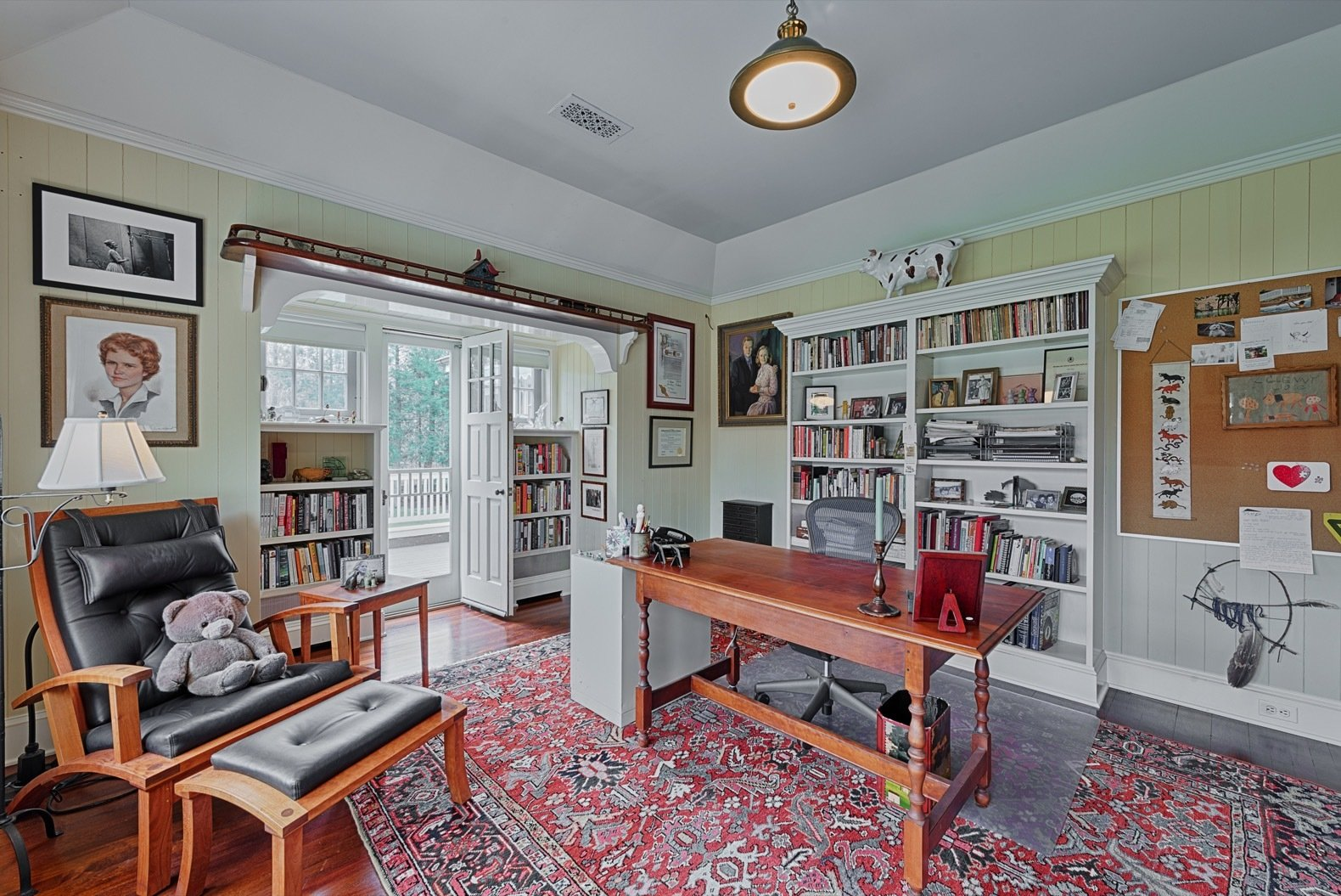 """Office, Bookcase, Study Room Type, Medium Hardwood Floor, Chair, and Desk Located off of the master bedroom is an office known as the """"Boat Room"""" with a wet bar and fridge. A door leads out to the sun porch.   Photo 10 of 17 in Glenn Close Lists Her Storybook Estate in New York For $3.6M"""