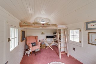 A look inside the children's playhouse with a lofted sleeping area.
