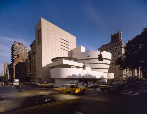 """Completed in 1959, the Solomon R. Guggenheim Museum (constructed 1956-1959) is an architectural icon that stands in stark contrast to its rectangular Manhattan neighbors with its curved surfaces. Wright famously said the museum would make the nearby Metropolitan Museum of Art """"look like a Protestant barn""""."""