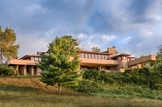 "Taliesin—a Welsh name that means ""shining brow""—is Wright's home, studio, school, and 800-acre agricultural estate located in Spring Green, Wisconsin on land that originally belonged to his maternal family. In addition to the residence, there are four more Wright-designed buildings on the estate."