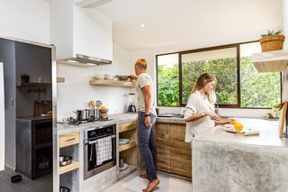 Mike and Lauren in the kitchen, which is outfitted with GE Profile and Ariston appliances.