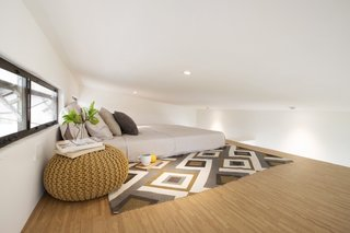 An additional sleeping space is located in the well-ventilated loft.