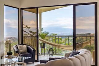 On the 100-square-foot covered balcony, a perfectly positioned hammock takes in panoramic mountain views in Puriscal.