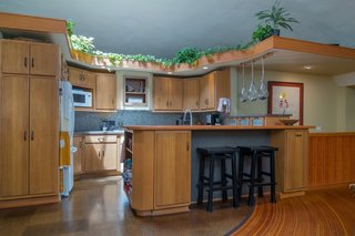 Located in the heart of the home, the kitchen was originally constructed with 20 feet of built-ins.