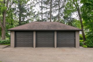 The property includes a detached three-car garage.