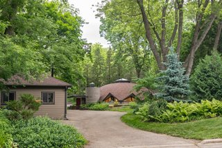 Set on a 0.371-acre lot, the Sunflower House is surrounded by mature maple, cedar, and walnut trees.