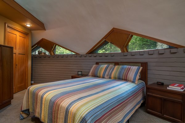 Previous owners combined the two tiny children's bedrooms to create a larger master bedroom with added storage.