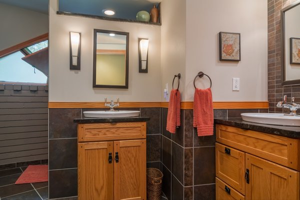 A peek inside the newly tiled bathroom. A second bathroom is located in the basement.