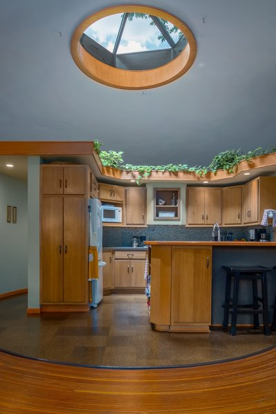The kitchen features a six-sided commercial double-pane skylight.