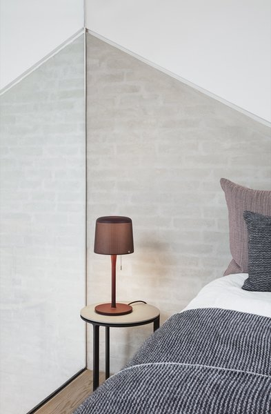 The Vipp table lamp ($259) that features a perforated metal lampshade and pull string.
