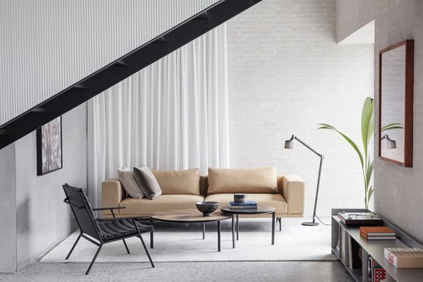 The light-filled living area is dressed with a Vipp Shelter lounge stol (available in Fall 2019), the Vipp Loft Sofa ($6,795), and a Vipp Floor Reading Lamp ($600).