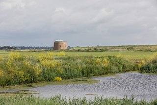 Surrounded by open farmland, the unique home is located approximately two-and-a-half hours from London on the east side of Bawdsey village.