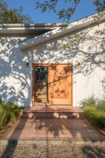 The Federal Bungalow is centrally located in a quiet residential neighborhood in Montauk and is a five-minute drive to the popular beach Ditch Plains. The door hardware is by Emtek and the house numbers are by Heath Ceramics.