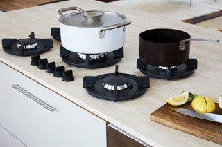 A close-up view of the PITT Cooking stovetop. The pots are by kindustrie.