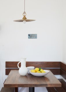 A kitchen nook with Heath Ceramics bowls occupies a corner of the living area.