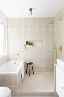 A glimpse into the master bath covered in tile by Heath Ceramics.