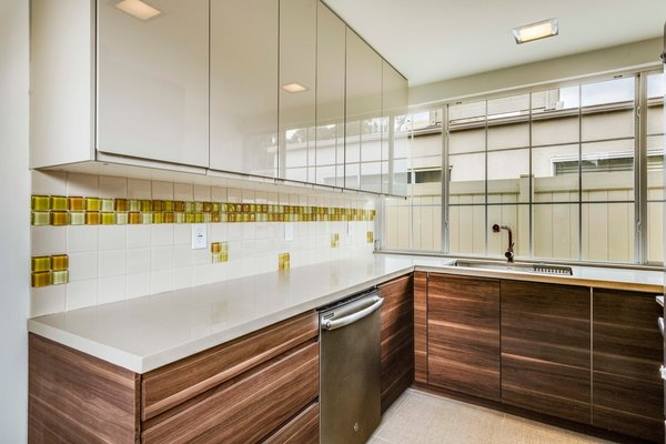 A peek inside the recently remodeled kitchen that's located off to the side from the entrance.
