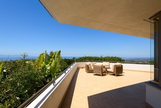A view of the living room terrace. The generous roof overhangs provide protection from direct sun.