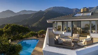 Set into the Santa Barbara foothills, the house offers uninterrupted views in all directions.