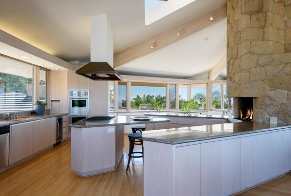 A triangular skylight brings additional light into the kitchen, which connects seamlessly with the living area and dining room.