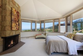 A glimpse inside a second bedroom with a fireplace.