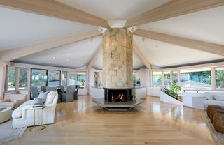 A floor-to-ceiling Santa Barbara stone fireplace anchors the heart of the great room.