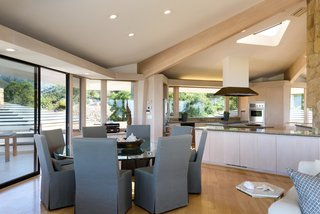 Exposed wood ceiling trusses help delineate the different spaces in the great room.